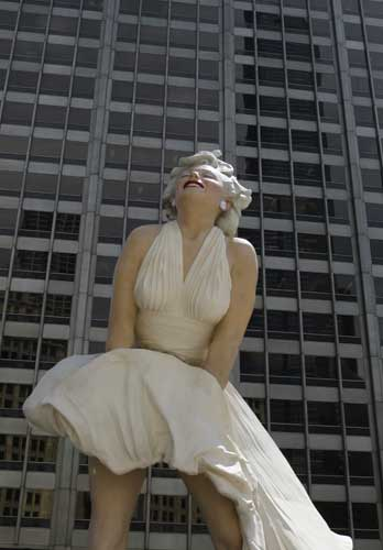 The face of Marilyn Monroe smiles on Seward Johnson&#39;s 26-foot-tall sculpture of Monroe, in her most famous wind-blown pose, on Michigan Ave. Friday, July 15, 2011 in Chicago.  <span class=meta>(AP Photo&#47;Charles Rex Arbogast)</span>